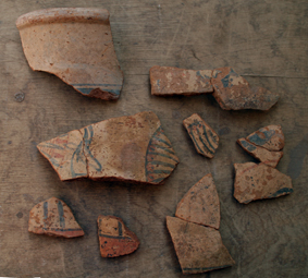 Fragments of a bichrome painted Nile clay jar from Elephantine.