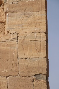 "Amenhotep III and the deity ""Nebmaatre, Lord of Nubia"", relief at Soleb."