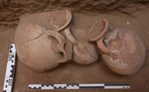 Three almost complete Pilgrim flasks were found together against the east wall of the shaft.