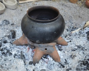 Our modern copies of ancient fire dogs holding a cooking pot above the fire place in Asparn.