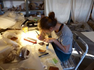 Michaela busy drawing pottery sherds.